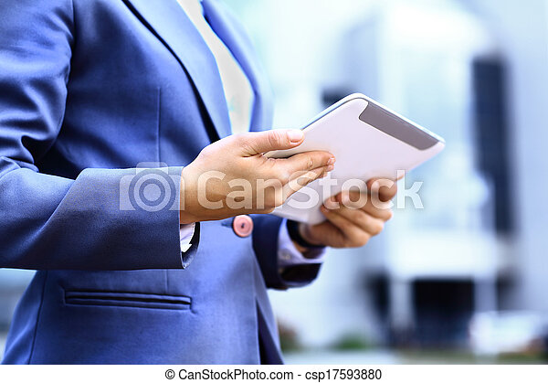 Close-up of woman working with digital tablet pc outdoor - csp17593880