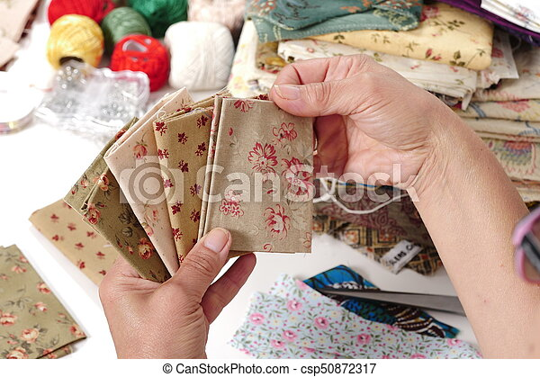 Close up of woman's hand sewing patchwork - csp50872317