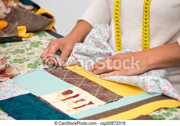 Close up of woman's hand sewing patchwork - csp50872318