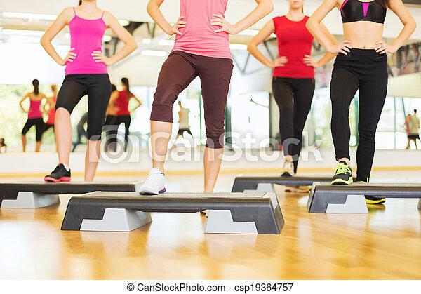 close up of women legs steping on step platform - csp19364757