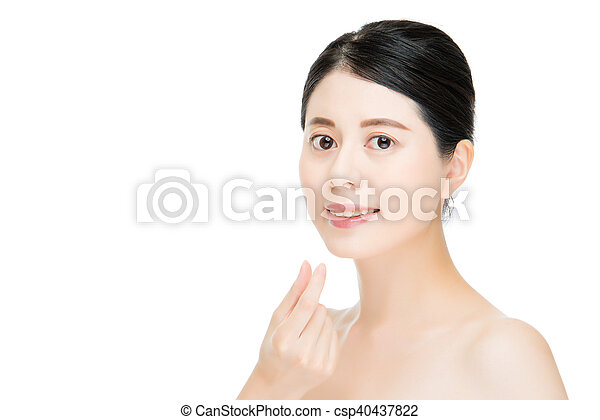 Close up of young smiling woman with hand finger gesture - csp40437822