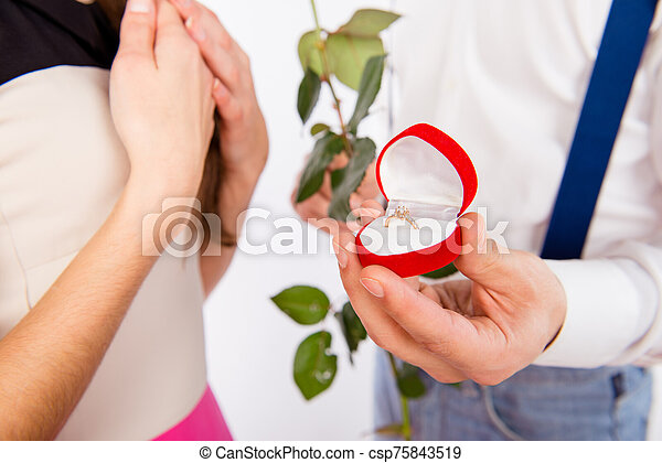 Close up photo of man making proposal of marrige with beautiful ring - csp75843519