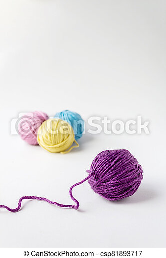 Close up photo of violet woolen ball. - csp81893717