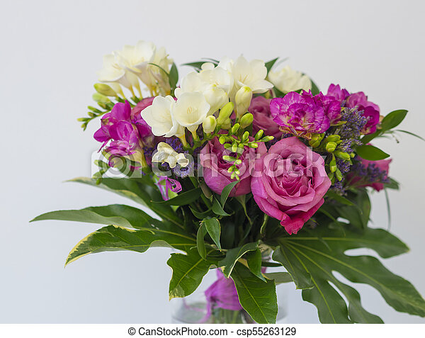 Close up pink rose and white freesia flower bouquet with stock close up pink rose and white freesia flower bouquet with green leaves decorative floral arangement mightylinksfo