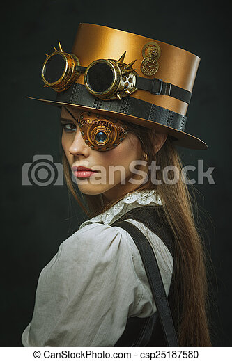Close-up portrait of a beautiful girl steampunk, hat and eyecup. - csp25187580