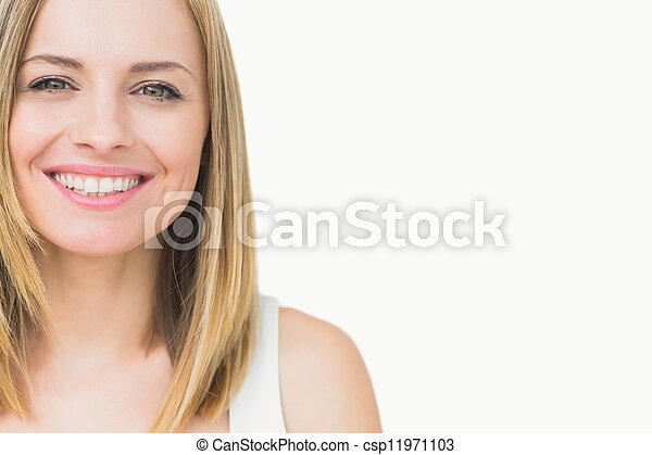 Close-up portrait of a cute young woman smiling - csp11971103