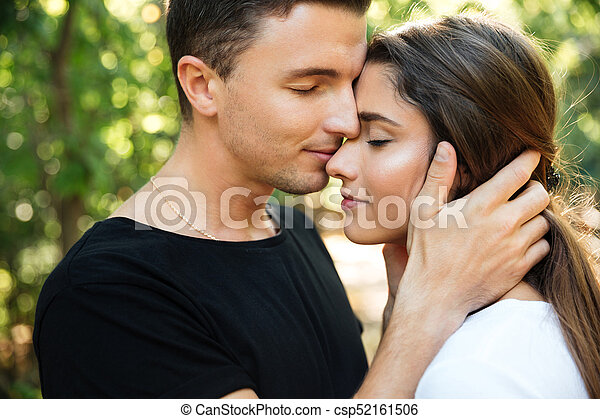 Close up portrait of a happy beautiful couple in love - csp52161506