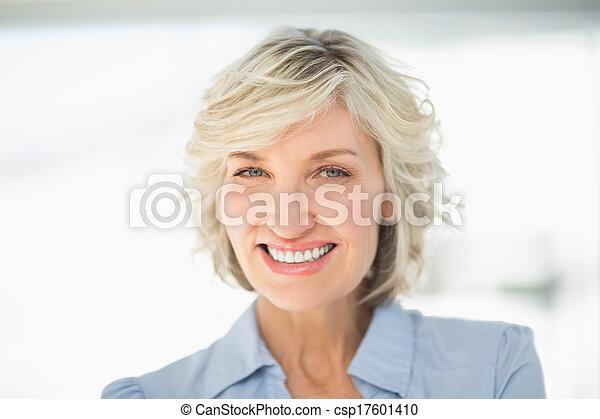 Close-up portrait of a smiling businesswoman - csp17601410
