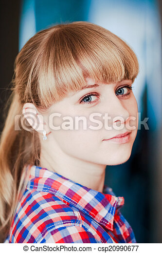 Close up portrait of a smiling young woman looking at camera - csp20990677