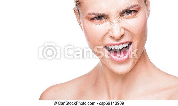 Close up portrait of amazing beautiful fashion woman saying yeah. Isolated on white background - csp69143909