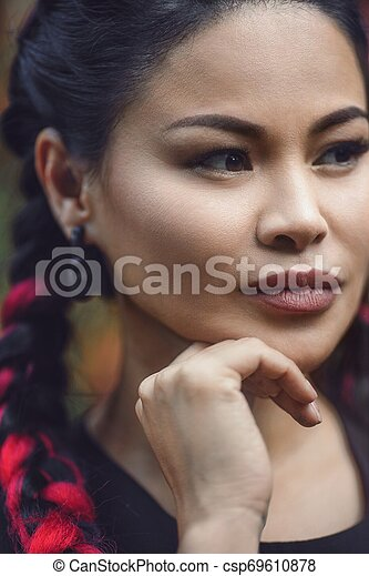 Close-Up Portrait of Beautiful Adult Asian Woman Outdoor - csp69610878