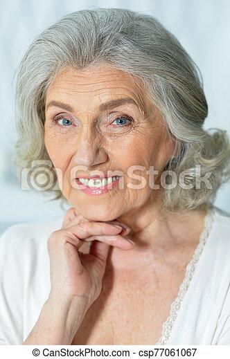 close up portrait of beautiful smiling senior woman - csp77061067