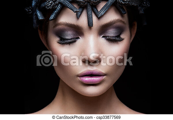 Close-up portrait of beautiful woman with bright make-up - csp33877569