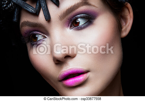 Close-up portrait of beautiful woman with bright make-up - csp33877558