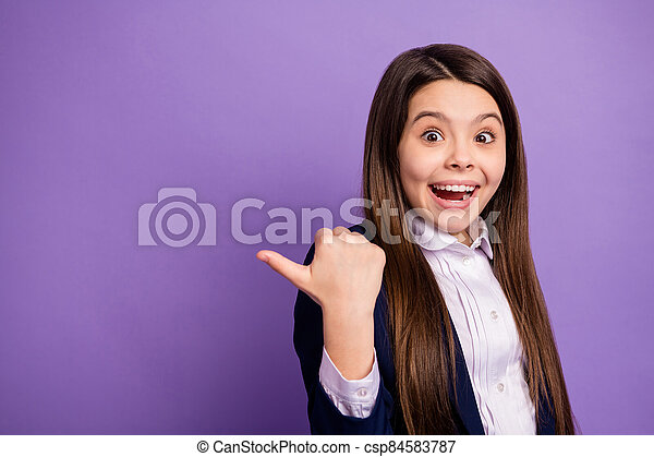 Close-up portrait of her she nice small little glad cheerful cheery amazed long-haired girl demonstrating copy space advice great news isolated bright vivid shine vibrant lilac violet color background - csp84583787