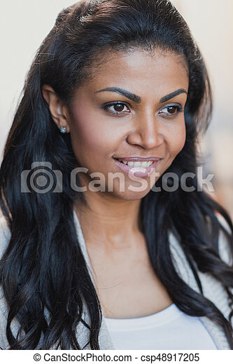 close up portrait of smiling young african american woman - csp48917205