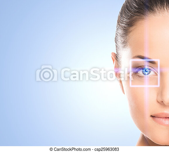 Close-up portrait of young and beautiful woman with the virtual hologram on her eyes (laser medicine and security technology concept) - csp25963083