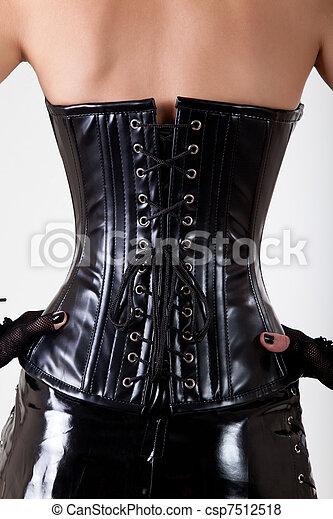 a7bcfbc136deb3 Close-up shot of woman wearing professional waist training black leather  corset - csp7512518