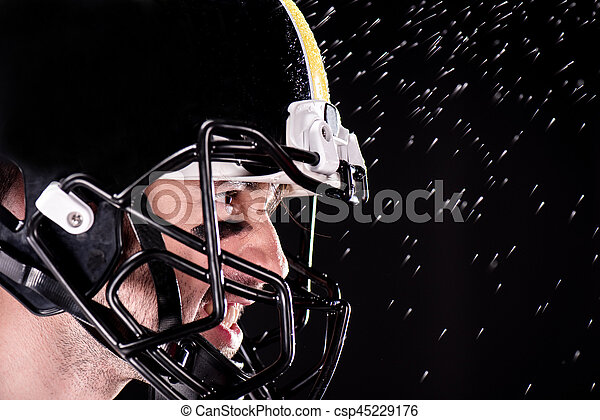 Close-up side view of angry man american football player in helmet - csp45229176