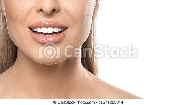 Close up smiling woman portrait on white background. Teeth care and teeth whitening concept. - csp71203014
