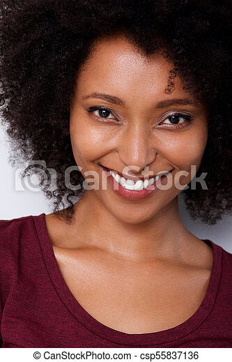 Close up smiling young african american woman with curly hair - csp55837136