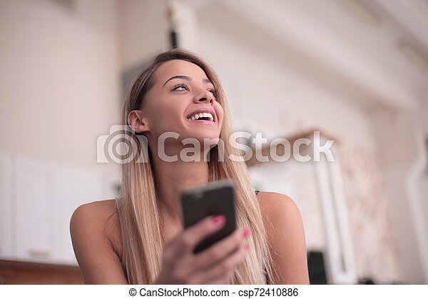 close up. smiling young woman with smartphone - csp72410886