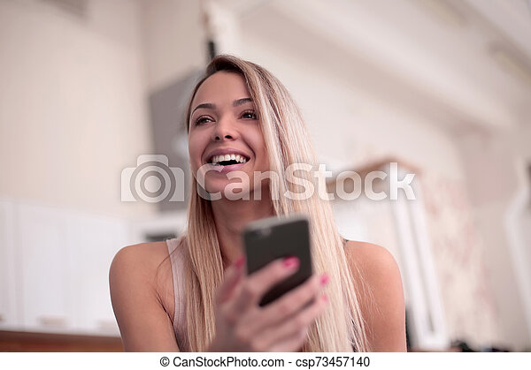 close up. smiling young woman with smartphone - csp73457140