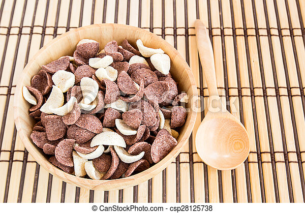 Close up sweet cereal in wooden bowl - csp28125738