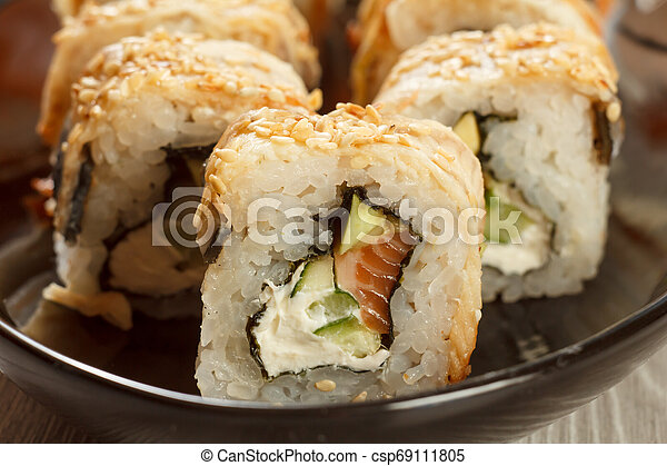Close up Uramaki with Conger. Sushi rolls with nori, rice and eel fish - csp69111805