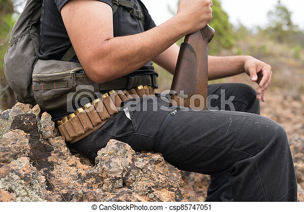 Close up view of an unrecognizable hunter with a shotgun. - csp85747051