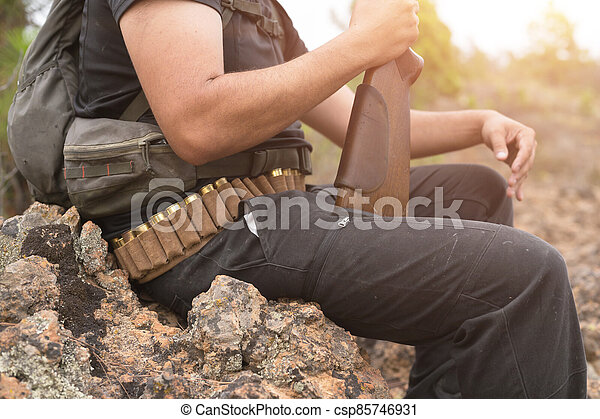 Close up view of an unrecognizable hunter with a shotgun. - csp85746931
