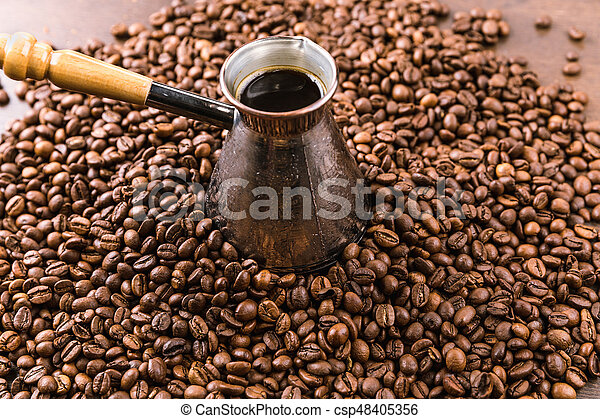 close up view of aromatic coffee beans and turk with coffee - csp48405356