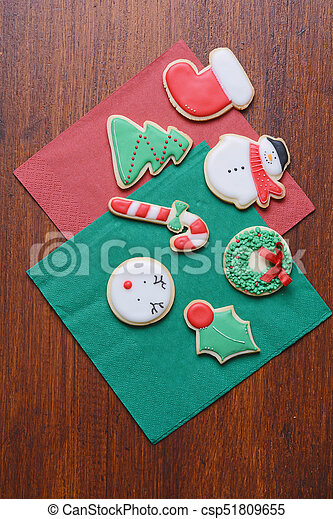 Close up view of Christmas cookies on wooden table - csp51809655