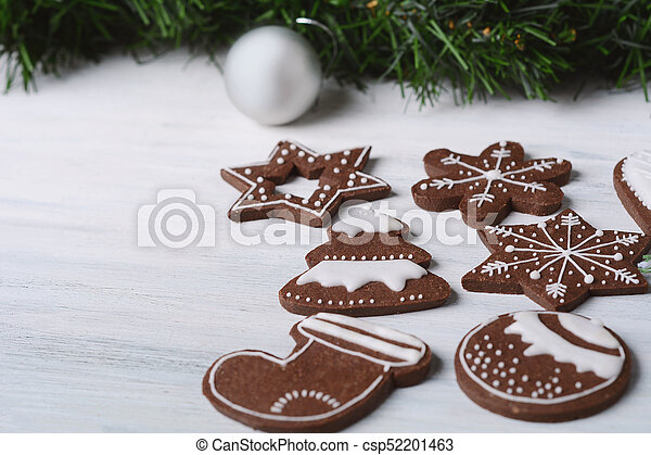 Close up view of Christmas cookies with festive decoration - csp52201463