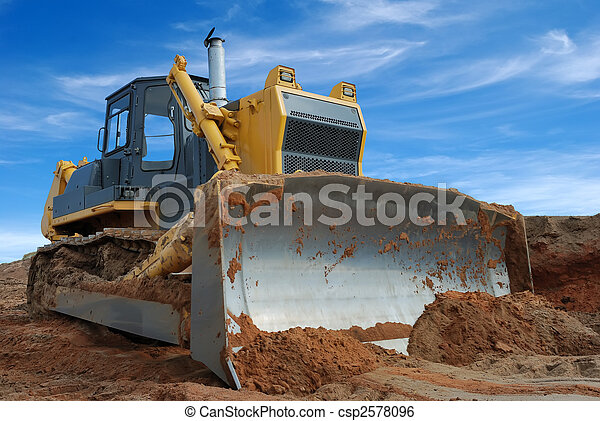 Close-up view of heavy bulldozer standing in sandpit - csp2578096