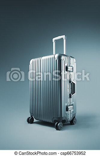 close up view of nice metal wheeled suitcase on blue background - csp66753952