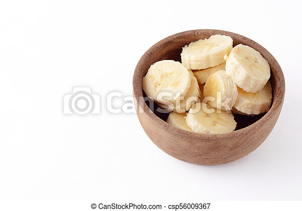 Close up view of wooden bowl with banana slices - csp56009367