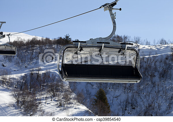 Close Up View On Chair Lift In Ski Resort