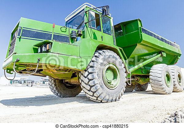 Close up view on dumper truck while he is passing over construction site. Low angle view - csp41880215