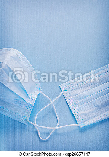 close up view on surgical mask blue background medical concep - csp26657147