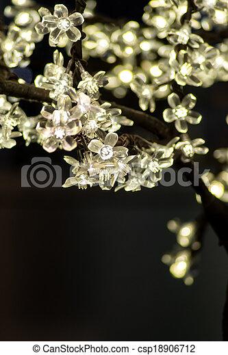 Close up white flower fairy lights fairy lights on tree in the close up white flower fairy lights csp18906712 mightylinksfo