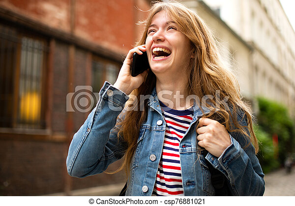 Close up young woman talking with mobile phone and laughing - csp76881021
