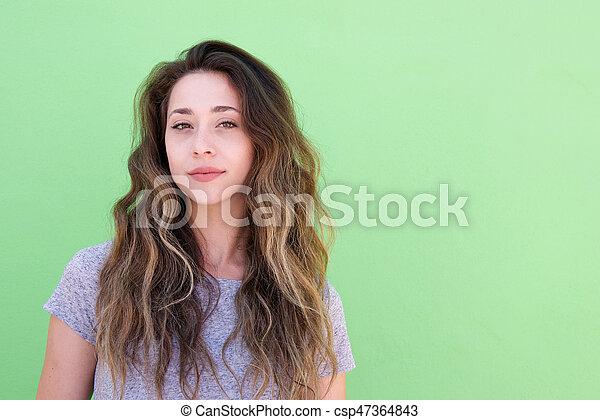 Close up young woman with long hair against green background - csp47364843