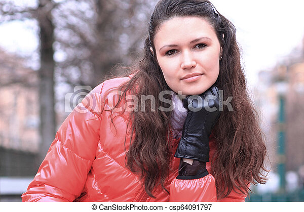 close up.beautiful young woman on the background of a winter city - csp64091797