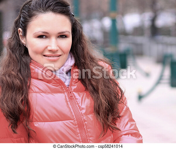close up.modern young woman on the background of a winter city - csp58241014