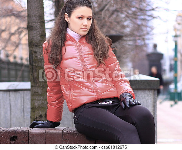 close up.pensive young woman on the background of a winter city - csp61012675