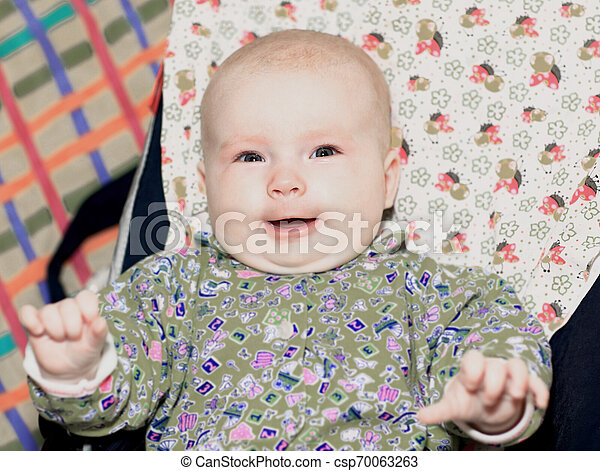 close up.portrait of a happy baby sitting in stroller - csp70063263