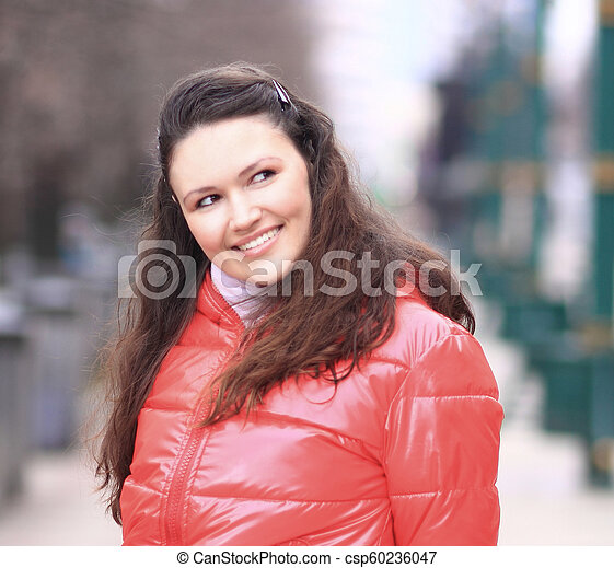 close up.smiling young woman on the background of a winter city - csp60236047