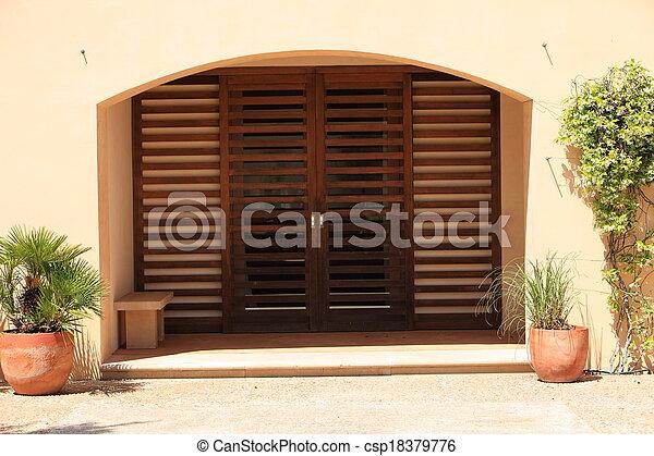 Closed Double Slatted Door Under A Recess   Csp18379776