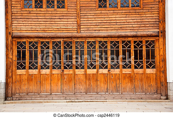 Closed wooden door and wall - csp2446119